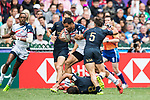 Martin Iosefo of USA is tackled by the Argentina defence during their Pool D match as part of the HSBC Hong Kong Rugby Sevens 2018 on 07 April 2018, in Hong Kong, Hong Kong. Photo by Yu Chun Christopher Wong / Power Sport Images