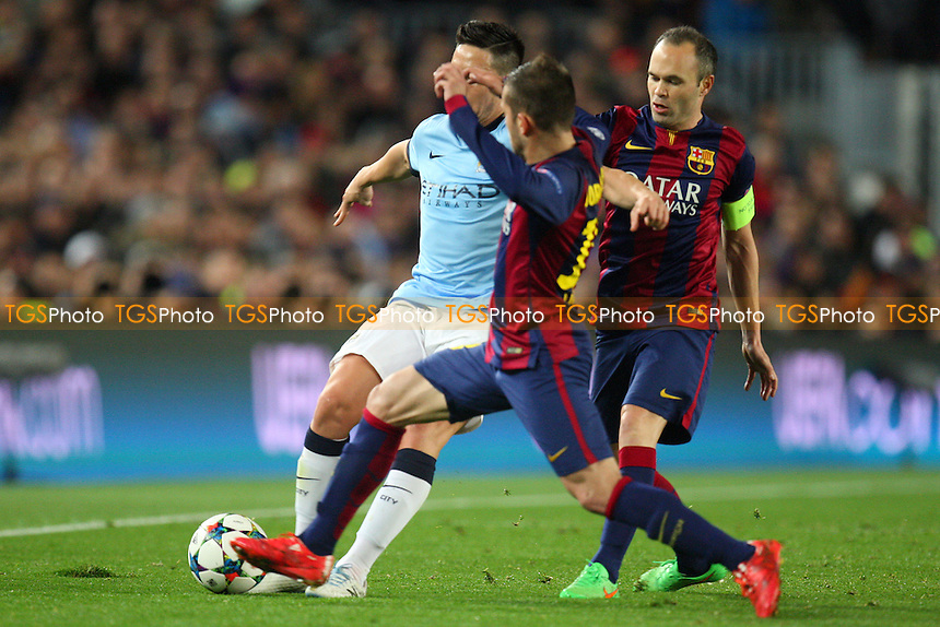 Samir Nasri of Manchester City is tackled by Jordi Alba of FC Barcelona - FC Barcelona vs Manchester City - European Champions League Round of Sixteen Football at the Camp Nou Stadium on  18/03/15 - MANDATORY CREDIT: Dave Simpson/TGSPHOTO - Self billing applies where appropriate - 0845 094 6026 - contact@tgsphoto.co.uk - NO UNPAID USE