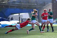 Beibhinn Parsons of Ireland evades the tackle Jasmine Joyce of Wales of during the Women's Six Nations match between Wales and Ireland at Cardiff Arms Park, Cardiff, Wales, UK. Sunday 17 March 2019