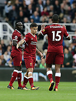 Liverpool's Philippe Coutinho (centre) celebrates scoring the opening goal with team-mate Daniel Sturridge<br /> <br /> Photographer Rich Linley/CameraSport<br /> <br /> The Premier League -  Newcastle United v Liverpool - Sunday 1st October 2017 - St James' Park - Newcastle<br /> <br /> World Copyright &copy; 2017 CameraSport. All rights reserved. 43 Linden Ave. Countesthorpe. Leicester. England. LE8 5PG - Tel: +44 (0) 116 277 4147 - admin@camerasport.com - www.camerasport.com