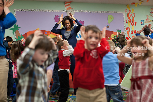 "First Lady Michelle Obama participates in the ""Bunny Pokey"" song and dance with kids in the Kinderbees Activty Room at Penacook Community Center in Penacook, New Hampshire, March 9, 2012. .Mandatory Credit: Lawrence Jackson - White House via CNP"
