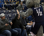 Dr. Stefan Franciosa get a high-five from the Nevada mascot  during a time out in an NCAA college basketball game against San Jose State in Reno, Nev., Wednesday, Jan. 9, 2019. (AP Photo/Tom R. Smedes)