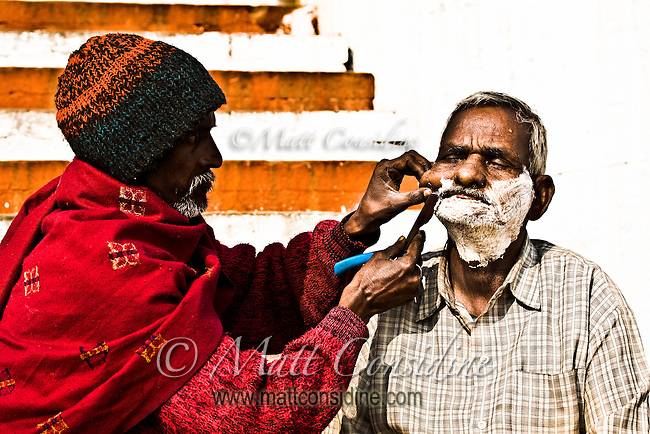 The strong contrast enhances the intense concentration evident in this ageless composition of life on the ghats of Varanasi.<br /> (Photo by Matt Considine - Images of Asia Collection)