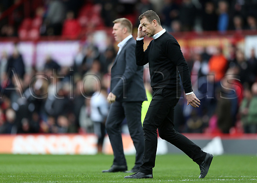 April 14th 2017,  Brent, London, England; Skybet Championship football, Brentford versus Derby County; Derby County Manager Gary Rowett looking concerned as he walks towards the dugout before the 2nd half kicked off alongside Brentford Manager Dean Smith