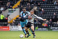Gozie Ugwu of Wycombe Wanderers  battles with Curtis Thompson of Notts County during the Sky Bet League 2 match between Notts County and Wycombe Wanderers at Meadow Lane, Nottingham, England on 28 March 2016. Photo by Andy Rowland.
