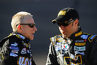 Apr 10, 2008; Avondale, AZ, USA; NASCAR Sprint Cup Series driver Mark Martin (left) talks with Matt Kenseth during qualifying for the Subway Fresh Fit 500 at Phoenix International Raceway. Mandatory Credit: Mark J. Rebilas-