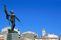 Statue of a soldier overlooking the old town of Bonifacio, Corsica, France.