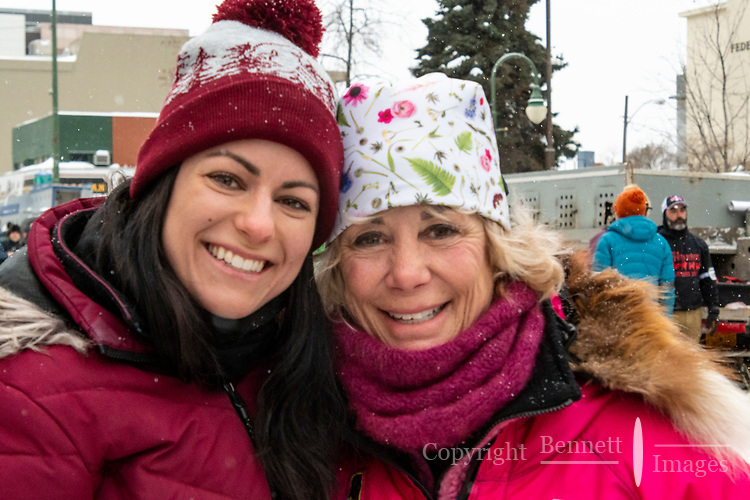 DeeDee Jonrow at 4th Avenue and D street in downtown Anchorage, Alaska on Saturday March 7th during the 2020 Iditarod race. Photo copyright by Cathy Hart