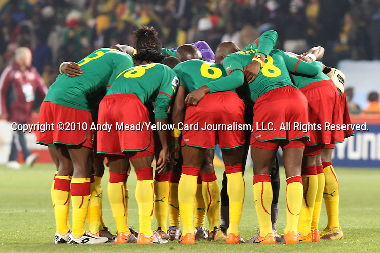 19 JUN 2010: Cameroon players huddle before the opening kick. The Denmark National Team defeated the Cameroon National Team 2-1 at Loftus Versfeld Stadium in Tshwane/Pretoria, South Africa in a 2010 FIFA World Cup Group E match.