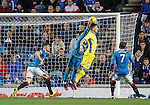 Wes Foderingham punches clear  from Graham Cummings