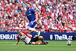 Olivier Giroud of Chelsea is challenged by Oriol Romeu of Southampton and gets a yellow card from Referee Martin Atkinson during the FA cup semi-final match at Wembley Stadium, London. Picture date 22nd April, 2018. Picture credit should read: Robin Parker/Sportimage