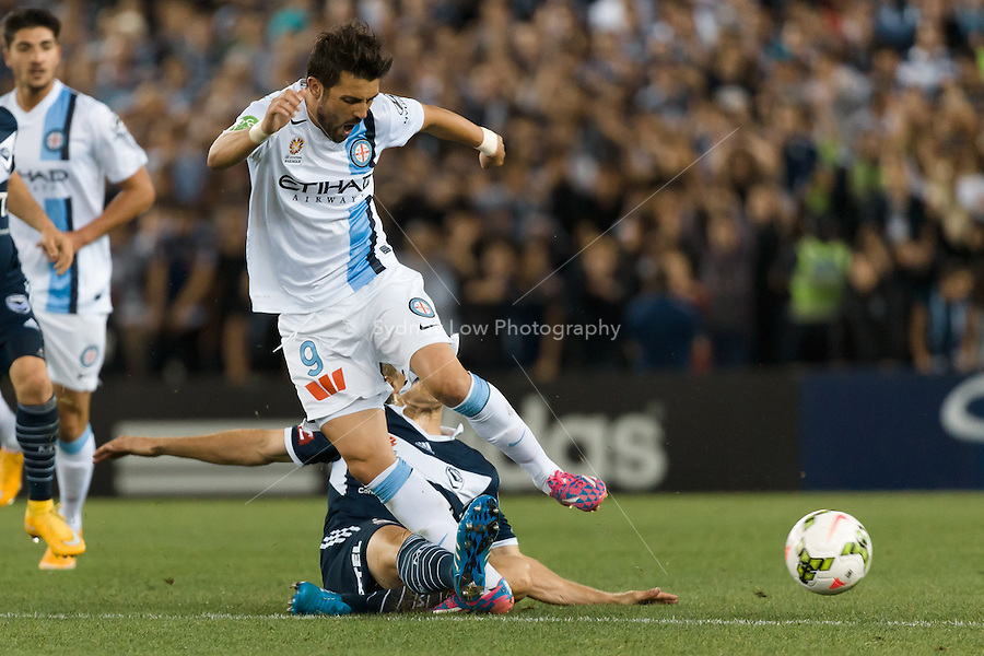 David VILLA of Melbourne City is tackled by Adrian LEIJER of the Victory in the round 3 match between Melbourne  Victory and Melbourne City in the Australian Hyundai A-League 2014-15 season at Etihad Stadium, Melbourne, Australia.