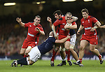 Scottish pair Scott Lawson and Jim Hamilton tackle Wales hooker Ken Owens.<br /> RBS 6 Nations 2014<br /> Wales v Scotland<br /> Millennium Stadium<br /> <br /> 15.03.14<br /> <br /> &copy;Steve Pope-SPORTINGWALES