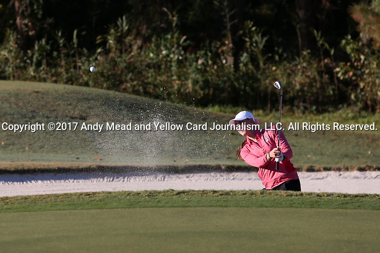 WILMINGTON, NC - OCTOBER 27: NC State's Cecily Overbey hits out of a sand trap on the first hole. The first round of the Landfall Tradition Women's Golf Tournament was held on October 27, 2017 at the Pete Dye Course at the Country Club of Landfall in Wilmington, NC.