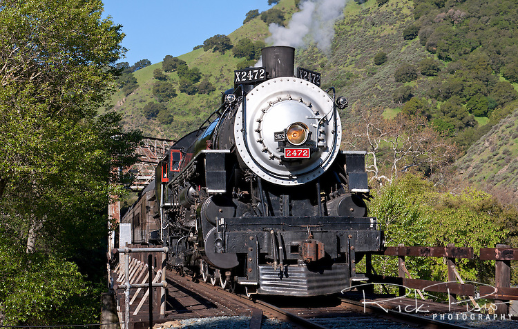 Former Southern Pacific Locomotive 2472 passes through Niles Canyon. Built by the Baldwin Locomotive Works in 1921, and used by the Southern Pacific Railroad until its retirement in 1956, No. 2472 was restored to operation by the Golden Gate Railroad Museum in 1991. It made its inaugural appearance at the Sacramento Railfair '91. The 150 ton steam locomotive is operated by the GGRM and operates on the Niles Canyon Railway for special events.