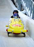18 December 2010: Elana Meyers crosses the finish line, finishing in 6th place for the USA at the Viessmann FIBT World Cup Bobsled Championships on Mount Van Hoevenberg in Lake Placid, New York, USA. Mandatory Credit: Ed Wolfstein Photo