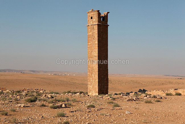 Stylite tower, 13m high, built for stylite monks, ascetic recluses who spent time in a room atop a secluded tower seeking solitude and practising meditation, Umm ar-Rasas, Amman, Jordan. The tower was in a square courtyard with huge Byzantine water cisterns and a church to the South. It has no staircase but a door opens on the South side of the domed roof room. A channel on the inside wall served as a toilet. Umm ar-Rasas is a rectangular walled city which grew from a Roman military camp in the Jordanian desert. Its remains date from the Roman, Byzantine and Umayyad periods (3rd - 9th centuries), including 16 churches with mosaic floors. Excavations began in 1986, although most of the site remains unexplored. It was declared a UNESCO World Heritage Site in 2004. Picture by Manuel Cohen