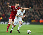 Jordan Henderson of Liverpool tackles Radja Nainggolan of AS Roma during the Champions League Semi Final 1st Leg match at Anfield Stadium, Liverpool. Picture date: 24th April 2018. Picture credit should read: Simon Bellis/Sportimage