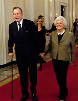 Washington, DC - January 7, 2009 -- Former United States President George H.W. Bush and former first lady Barbara Bush arrive to make remarks at Reception in Honor of the Points of Light Institute in the East Room of the White House in Washington, D.C. on Wednesday, January 7, 2009..<br /> CAP/MPI/RS<br /> &copy;RS/MPI/Capital Pictures