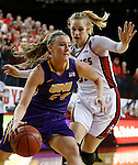 VERMILLION, SD - MARCH 24, 2016 -- Angie Davison #11 of Northern Iowa drives past Nicole Seekamp #35 of South Dakota  during their WNIT game Thursday evening at the Dakotadome in Vermillion, S.D.  (Photo by Dick Carlson/Inertia)