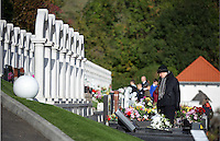 I WAS INFORMED THAT ACCORDING TO THE 1847 CEMETERIES ACT IT IS AN OFFENCE TO TAKE PICTURES IN CEMETERIES<br /> Pictured: A woman pays her respects at the Aberfan Cemetery. Friday 21 October 2016<br /> Re: Wales has fallen silent as the country remembered the Aberfan disaster 50 years ago.<br /> On 21 October 1966, a mountain of coal waste slid down into a school and houses in the Welsh village, killing 144 people, including 116 children.<br /> A day of events to commemorate the disaster included a service at Aberfan Cemetery at 9:15am on Friday.<br /> Prince Charles is visiting Aberfan memorial garden before unveiling a plaque in memory of the victims.<br /> He will also attend a reception with the families of some of those who lost their lives, before signing a book of remembrance.