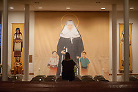 A woman makes a picture of a mural in the chapel above the tomb of St. Katharine Drexel at the National Shrine of St. Katharine Drexel Saturday, December 30, 2017 in Bensalem, Pennsylvania. Drexel was an American heiress who dedicating herself to work among the American Indians and African-Americans in the western and southwestern United States. She was canonized a saint by the Roman Catholic Church in 2000. (Photo by William Thomas Cain/Cain Images)