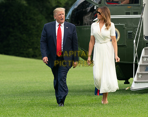 United States President Donald J. Trump and first lady Melania Trump return to the White House in Washington, DC after spending a weekend at their residence in Bedminster, New  Jersey on Sunday, July 7, 2019.<br /> CAP/MPI/RS<br /> ©RS/MPI/Capital Pictures