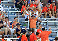 A fan catch a ball throw by former UVa quarterback Mike Rocco during the game Saturday Sept. 6, 2014 at Scott Stadium in Charlottesville, VA. Virginia defeated Richmond 45-13. Photo/Andrew Shurtleff
