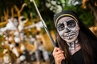 A Salvadoran girl with skull face paint performs in the La Calabiuza parade at the Day of the Dead festivity in Tonacatepeque, El Salvador, 1 November 2016. The festival, known as La Calabiuza since the 90s of the last century, joins Salvador's pre-Hispanic heritage and the mythological figures (La Sihuanaba, El Cipitío, La Llorona etc.) collected from the whole Central American region, together with the catholic All Saints Day holiday and its tradition of honoring the dead relatives. Children and youths only, dressed up in scary costumes and carrying painted carts, march from the local cemetery to the downtown plaza where the party culminates with music, dance, drinking and eating pumpkin (Ayote) with honey.