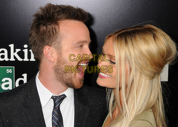 Aaron Paul, Lauren Parsekian<br /> &quot;Breaking Bad&quot; Final Episodes Los Angeles Premiere Screening held at Sony Pictures Studios, Culver City, California, USA, 24th July 2013.<br /> portrait headshot  grey gray black suit tie green khaki funny mouth open profile <br /> CAP/ADM/BP<br /> &copy;Byron Purvis/AdMedia/Capital Pictures