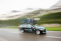 Team SKY teamcar speeding down the Passo San Pellegrino (1918m) descent trying to keep up with the riders<br /> <br /> 2014 Giro d'Italia<br /> stage 18: Belluno - Rifugio Panarotta (Valsugana), 171km