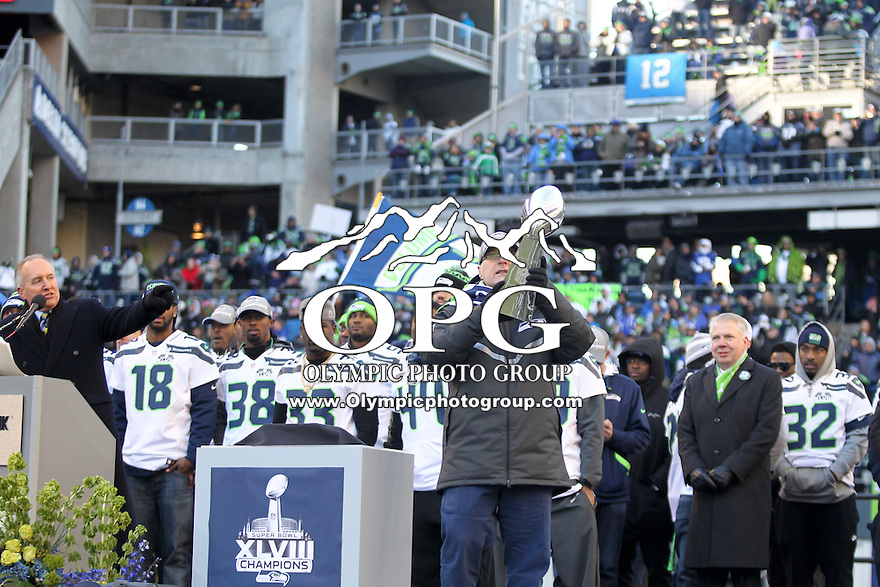 2014-02-05:  Chairman, Seattle Seahawks and First & Goal Inc Paul Allen hoisted the Lombardi Trophy in the air for fans to see. Seattle Seahawks players and 12th man fans celebrated bringing the Lombardi trophy home to Seattle during the Super Bowl Parade at Century Link Field in Seattle, WA.