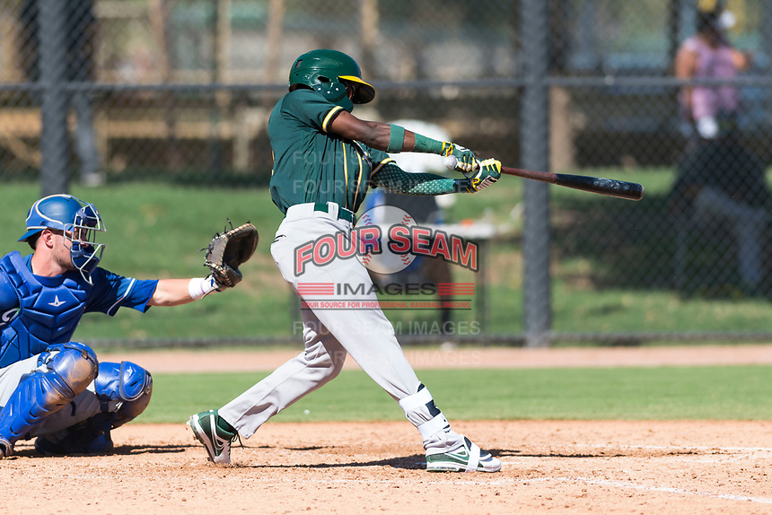 Oakland Athletics second baseman Marcos Brito (5) swings at a pitch during an Instructional League game against the Los Angeles Dodgers at Camelback Ranch on September 27, 2018 in Glendale, Arizona. (Zachary Lucy/Four Seam Images)
