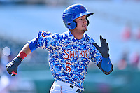 Tennessee Smokies center fielder Albert Almora Jr. (6) runs to first during a game against the Birmingham Barons on August 2, 2015 in Kodak, Tennessee. The Smokies defeated the Barons 5-2. (Tony Farlow/Four Seam Images)