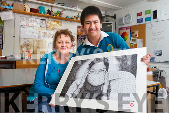 Ann O'Shea Daly, a teacher at Mercy Mounthawk Secondary School, pictured with Allen Ybanez, who has won the Special Merit Award in he 63rd Texaco Children's Art competition.