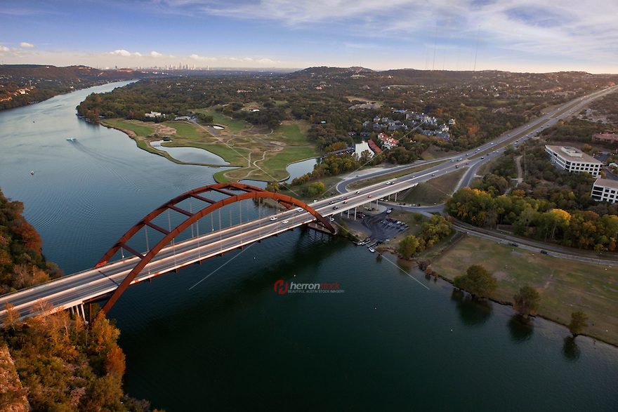 Austin Texas Pennybacker 360 Bridge sunset sky view from helicopter