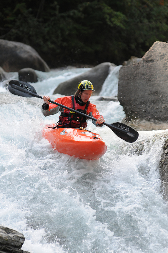 Carl Jacks paddling a waterfall on Kaslo River.    Cover photo on  Summer 2012 West Kootenay 'Go and Do' guide.
