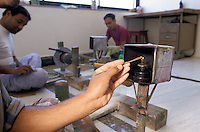 In Jaipur India, the world capital leader of Emerald cutter, those mens are in charge of giving the first rough polishing on the stone
