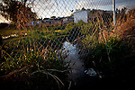 Raw sewage flows from the Rancho Garcia trailer park onto adjoining agricultural land in Thermal, Calif., March 8, 2012.