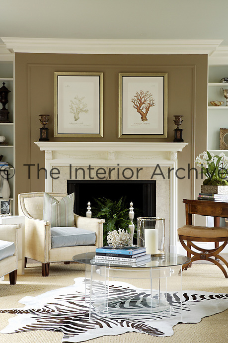 A pair of club chairs with mohair cushions furnishes the fireplace end of this elegant living room