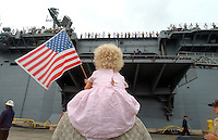 X.marinesDeploy.2.0822.jl.jpg/photo lytle/One year old Liv Annika Stevenson sits on her father Jerry Stevenson's shoulders as she watches her mother Navy Captain  Kristin Solberg being deployed to the gulf  for 8 months on the USS Peleliu (LHA 5) Thursday in San Diego.