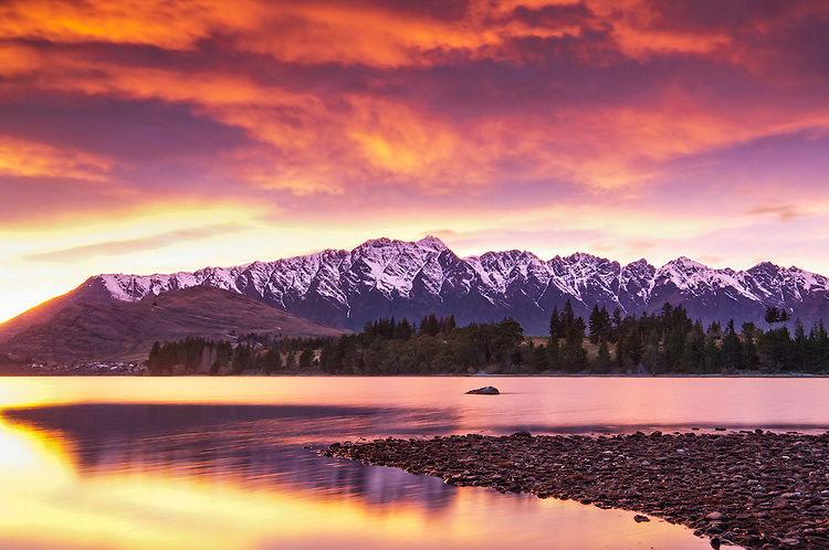 A vivid red sunrise over the Remarkables mountains and Lake Wakatipu NZ. Canvas & fine art prints available