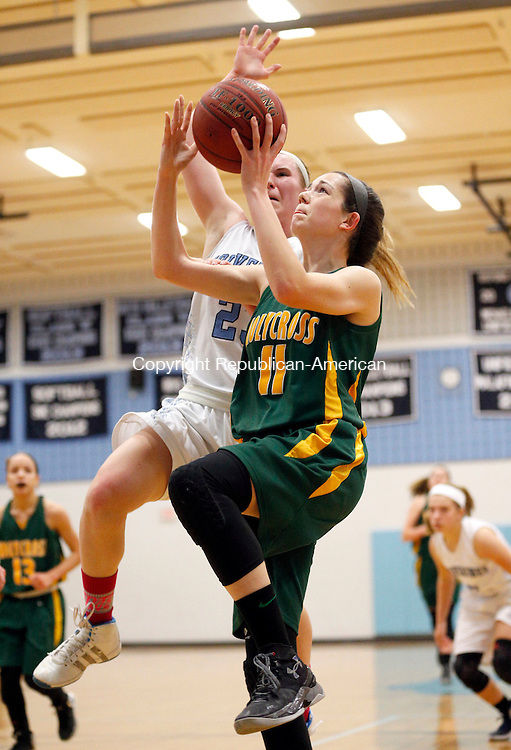 Oxford, CT- 21 January 2016-012116CM10- Holy Cross' Kaitlyn Grimshaw takes the ball to the hoop against Oxford's Meghan Sastram during their NVL matchup in Oxford on Thursday.    Christopher Massa Republican-American