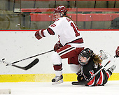 Cori Bassett (Harvard - 18), Alyssa Wohlfeiler (NU - 8) - The Harvard University Crimson defeated the Northeastern University Huskies 1-0 to win the 2010 Beanpot on Tuesday, February 9, 2010, at the Bright Hockey Center in Cambridge, Massachusetts.