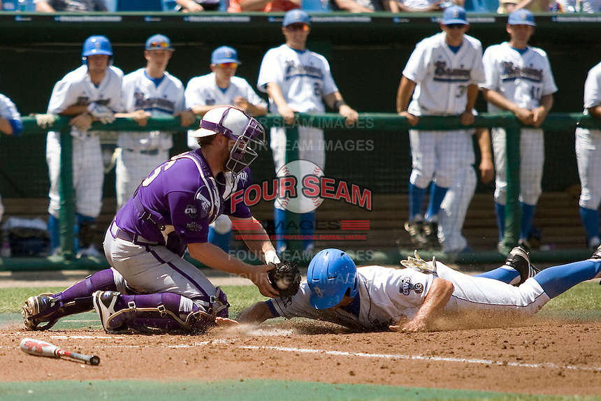 TCU catcher Bryan Holaday tags out a UCLA baserunner in Game 13 of the NCAA Division One Men's College World Series on June 26th, 2010 at Johnny Rosenblatt Stadium in Omaha, Nebraska.  (Photo by Andrew Woolley / Four Seam Images)