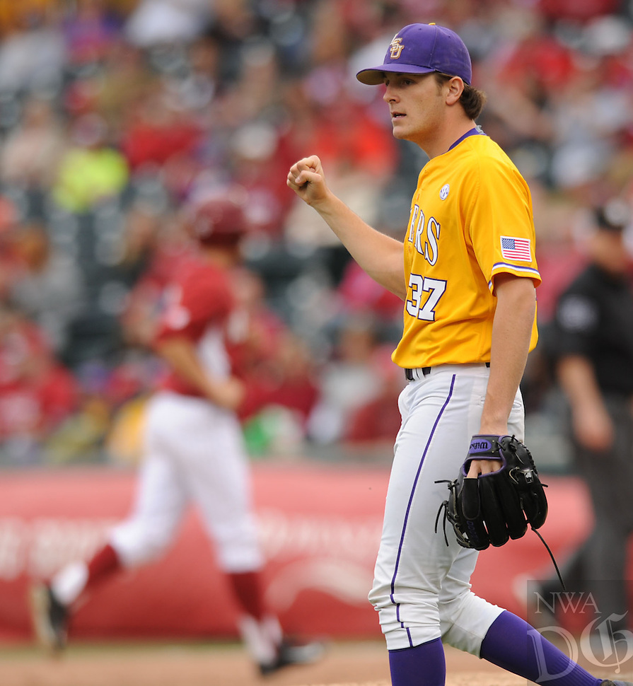NWA Democrat-Gazette/ANDY SHUPE - Closer Jesse Stallings of LSU celebrates the second out of the eighth inning against Arkansas Saturday, March 21, 2015, at Baum Stadium in Fayetteville. Visit nwadg.com/photos for more photos from the game.