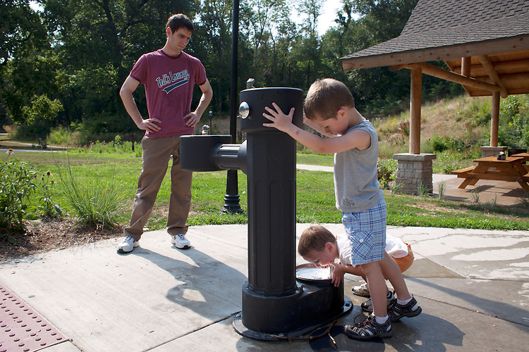 Some parenting differences are funny. I don't let the boys use the dog drinking fountain, but after I saw this happen, I had to concede that it probably wasn't harmful. Here my husband takes our sons, age six and age three, on a scooter walk.