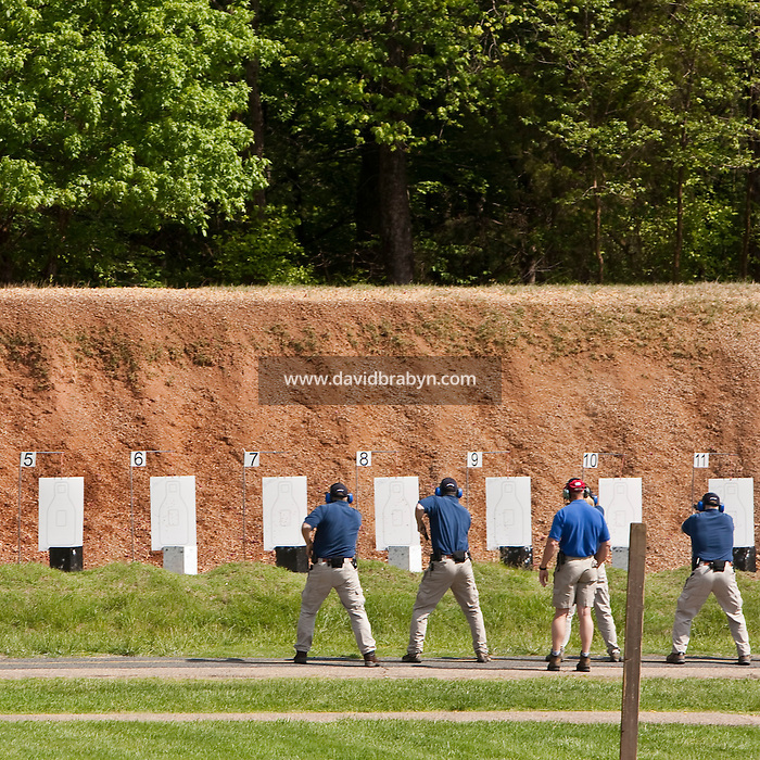 Trainees practice on the firing range at the FBI Academy in Quantico, VA, USA, 12 May 2009.