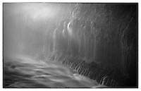 A mist shrouded Icelandic waterfall.