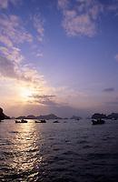 Sunset behind fishing boats, Halong Bay, Vietnam.